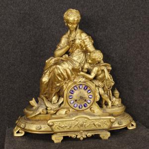 Orologio francese in antimonio dorato