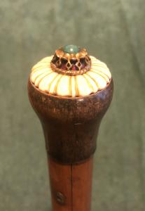 Stick with horn and ivory knob with hard stone.