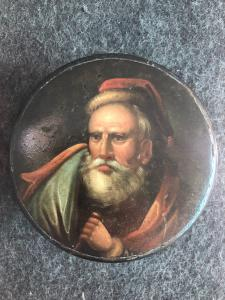 Painted papier mache snuff box with the face of a man with a beard. Holland