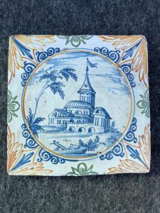 Majolica tile-tile with landscape decoration.Lodi