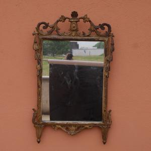 Small Louis XVI mirror in antique gold leaf from the end of the 18th century