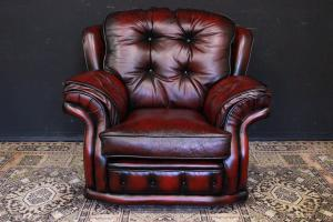 Original English Chesterfield bergere model armchair in burgundy leather