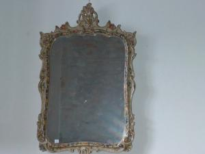 Particular mirror in painted ceramic and with relief motifs in excellent condition.