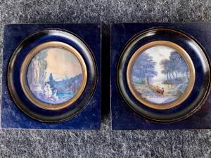 Pairs of miniatures on cardboard with characters on a rural background.
