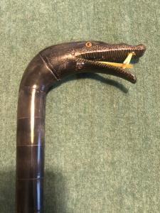 All-horn stick made up of segments on a flexible core depicting a snake.