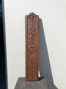 Carved chestnut wood frieze with floral motifs and date 1826.