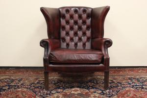 Original Chestefield armchair in burgundy-brown leather