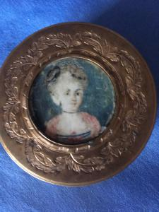 Eighteenth century engraved gold-like box with miniature on ivory