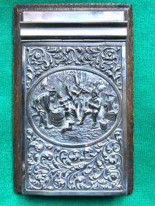 Porta block-notes in legno di palissandro e argento sbalzato con scena paesana e motivi vegetali.Olanda.