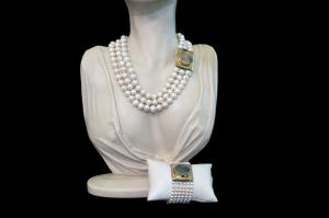 Necklace and bracelet of natural white pearls with firm mother-of-pearl