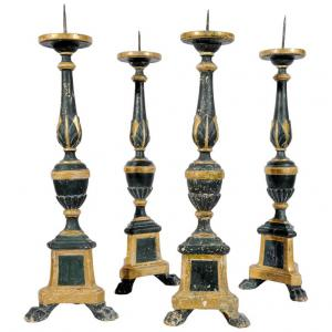 Series of four ancient Italian wooden candlesticks