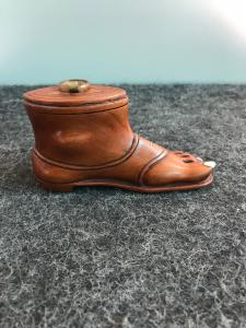 Wooden tobacco box in the shape of a foot with sandal. Ivory nails. Europe