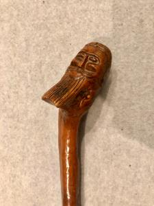 Stick in a single piece in boxwood with knob representing a Persian head.