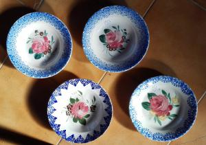 group of four painted plates