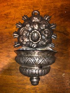 Holy water stoup in embossed silver.North Italy.