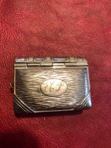 Silver plated brass matchbox and coin holder in the shape of an album.