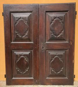 pair of walnut doors with baroque motifs