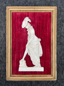 Bas-relief in ivory with frame depicting an erotic scene with a female figure. France.