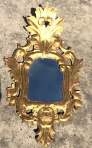 Specchiera in legno scolpito e foglia oro.Venezia.