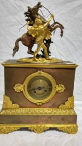 Table clock in gilded bronze and burnished Napoleon III France period