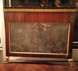 Splendida specchiera lucchese del primo periodo impero, finemente intagliata e specchio coevo.