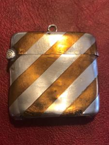 Silver matchbox with geometric striped decoration.England.