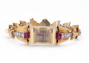 Reloj de pulsera Lady Jaeger en oro de 18 k con diamantes (1,80 ct) y rubíes, años 30