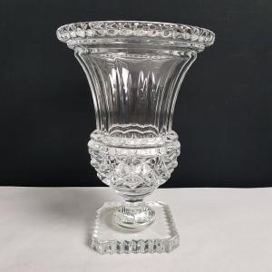 Jarrón en centro de mesa de cristal
