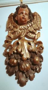 Coppia di fregi dorati Con testa di putto