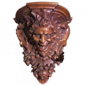 Mensola intagliata in legno di noce raffigurante testa di satiro