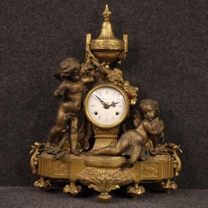 Orologio francese in bronzo e antimonio dorato
