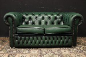 Original Chesterfield club two-seater sofa in bottle green leather