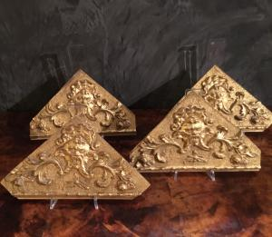 Four friezes in gold leaf wood with central mask. Louis XVI period