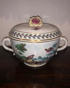 Porter's mug in 'bastard boulder' porcelain, with decoration of birds in a rural setting.Doccia, Ginori.