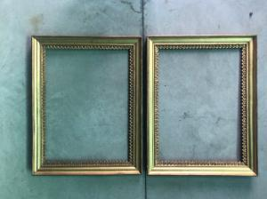 Pair of carved wooden frames and gold leaf with stylized plant motifs.
