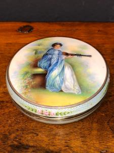 Silver and enamel box decorated with a lady figure.