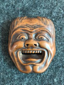 Small boxwood mask depicting a commedia dell'arte character. Japan
