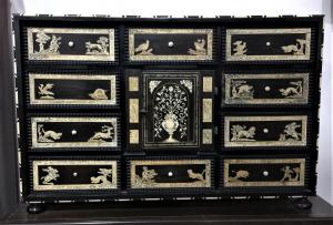 Monetary in ebony and rosewood with ivory inlays