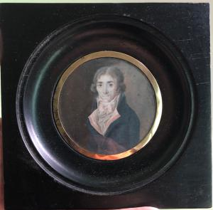 Miniature oil on ivory with male character. Low gold profile.