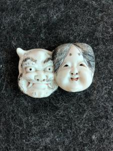Netsuke 'in ivory with two faces: female face and demon. Japan