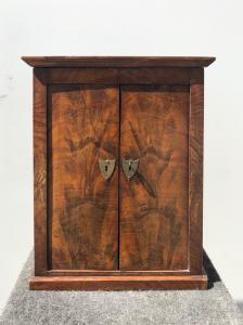 Model of wardrobe in walnut veneered in briar.