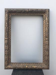 Carved and gilded wooden frame with plant motifs in relief.