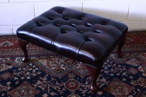 Original Chesterfield pouf Made in the UK, in burgundy leather.