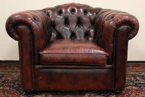 Original Chesterfield club armchair in red-brown leather