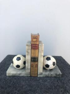 Pair of marble bookends with soccer ball.