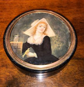 Papier mache box with ivory miniature depicting a lady with a bird.France.
