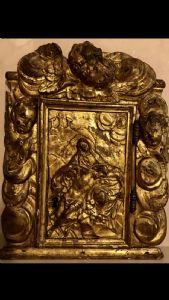 Pacca in legno intagliato e dorato