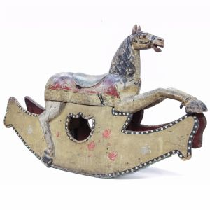 Rocking horse in painted wood.