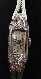 Wrist watch for women in white gold and glitter