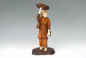 Okimono peasant ivory wood